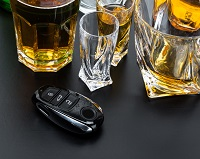 Alcohol and a car key on a table - DUI attorney Long Beach, CA